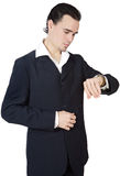 Attractive executive young person watching the clock stock photography