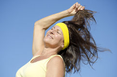 Attractive exercising mature woman isolated outdoor Stock Photography