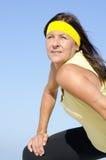 Attractive exercising senior woman sky  Stock Photos