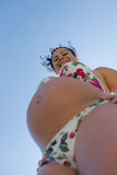 Attractive expectant mother in swimwear looking top down smiling Royalty Free Stock Photos