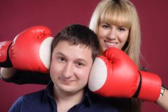 Attractive family couple in  boxing gloves on red Royalty Free Stock Image