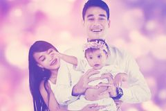 Attractive family with defocused background Stock Photos