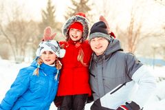 Family winter in the snow. Attractive family having fun in a winter park Stock Photos