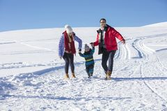 Attractive family having fun in a winter park on mountain Royalty Free Stock Photo