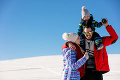 Attractive family having fun in a winter park on mountain Royalty Free Stock Photography