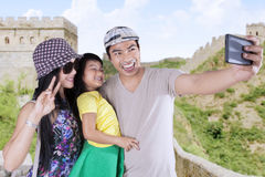 Attractive family taking pictures in the Great Wall Stock Images