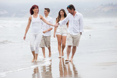Attractive Family walking on the Beach