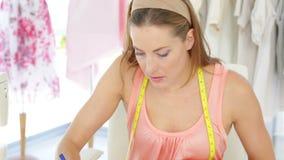 Attractive fashion designer sketching a design stock footage