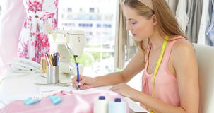 Attractive fashion designer sketching at table stock video