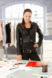 Attractive fashion designer standing by desk Stock Photography