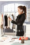 Attractive fashion designer talking on phone stock photography