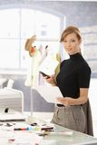 Attractive fashion designer working at desk Stock Photo