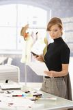 Attractive fashion designer working at desk Stock Image