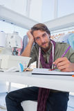 Attractive fashion designer working at his desk Stock Photography
