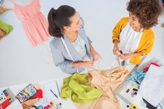 Attractive fashion designers working with textile Stock Images