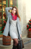 Attractive fashion girl in coat on the city street Stock Photo