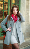 Attractive fashion girl in coat on the city street Royalty Free Stock Image