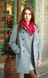 Attractive fashion girl in coat on the city street Royalty Free Stock Photography
