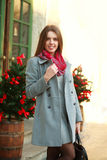 Attractive fashion girl in coat on the city street Royalty Free Stock Photo