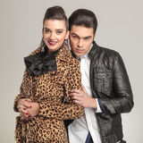 Attractive fashion man holding his girlfriend Royalty Free Stock Photo