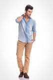 Attractive fashion man walking on studio background Stock Photo