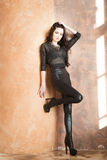 Attractive fashion woman in black leather pants Stock Photography