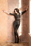 Attractive fashion woman in black leather pants Royalty Free Stock Photo