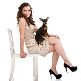 Attractive fashion woman with dog Royalty Free Stock Photo