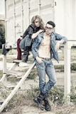 Attractive fashionable couple wearing jeans Stock Photography