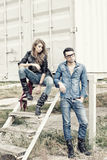 Attractive fashionable couple wearing jeans Stock Photos