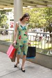 Attractive fashionable shopping girl on the street with colorful shopping bags. Let s go shopping, glamorous fashion lady stock photography