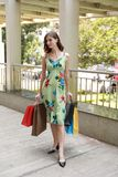 Attractive fashionable shopping girl on the street with colorful shopping bags. Let s go shopping, glamorous fashion lady royalty free stock photography