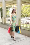 Attractive fashionable shopping girl on the street with colorful shopping bags. Let s go shopping, glamorous fashion lady royalty free stock images