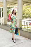 Attractive fashionable shopping girl on the street with colorful shopping bags. Let s go shopping, glamorous fashion lady royalty free stock photo