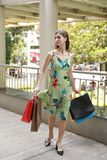 Attractive fashionable shopping girl on the street with colorful shopping bags. Let s go shopping, glamorous fashion lady stock image