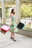 Attractive fashionable shopping girl on the street with colorful shopping bags. Let s go shopping, glamorous fashion lady stock photo