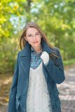 Attractive fashionable woman outdoors in autumn Royalty Free Stock Image