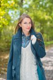 Attractive fashionable woman outdoors in autumn Stock Image