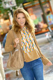 Attractive fashionable woman went shopping Stock Images
