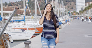 Attractive fashionable young woman on her mobile Royalty Free Stock Images