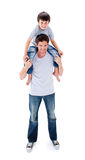 Attractive father giving his son piggyback ride Stock Images
