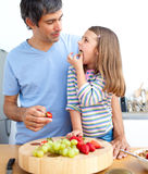 Attractive father and his girl having breakfast Stock Image
