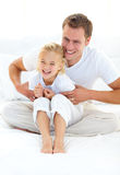 Attractive father playing with his little girl Royalty Free Stock Photography