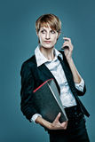 Attractive femael office worker holding a folder Royalty Free Stock Photos