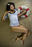 Attractive femail in sailor suit Stock Image