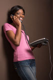 Attractive female african worker talking on phone. Royalty Free Stock Photo