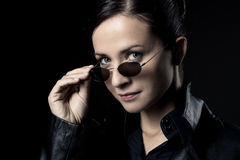 Attractive female agent in black leather coat Stock Photo