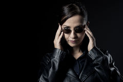 Attractive female agent in black leather coat Stock Image