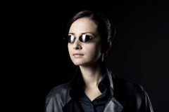 Attractive female agent in black leather coat Stock Photos