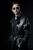 Attractive female agent in black leather coat Royalty Free Stock Image